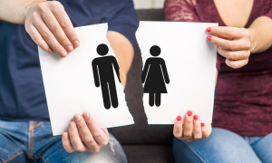 Couple in separation process sitting on couch showing diagram of separation